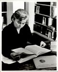 Faculty Member Reading, Admin Faculty ca. 1950s - 60s