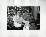 Behind the Cash Register at the Art Institute of Boston Supply Store, Faculty/Staff ca. 1960s by Don Sanford
