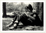 Student sitting against tree, 1983 by Peter Travers