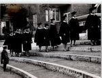 Girl and the Graduates Ascend the Stairs, Commencement ca. 1940s - 50s
