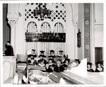 Administrators and Faculty Seated in the Chapel, Commencement ca. 1960s