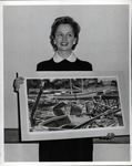 Woman holding a painting by School of Practical Art