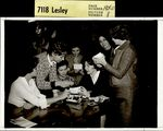 Seven Students Pouring Over Photos, Student Groups ca. 1950s