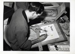 Arthur Silverman Working on Lettering At a Drafting Table by School of Practical Art