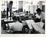 Bill Reed Instucts His Class As They Sketch a Figure Study by R. L. Dorthard Associates