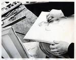 Student works on Sketch