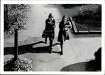 Two Students Walking Down the Cracked Road, Student Life ca. 1960s